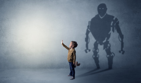 Little boy's self image appear as a big robotman shadow on his background  Imagens