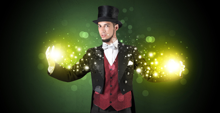 Magician sparkling super power between his two hands Stock Photo