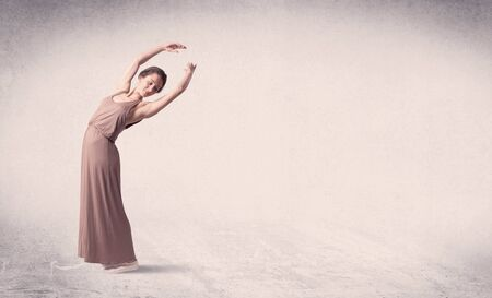 Modern ballet dancer performing art jump with empty copy space background