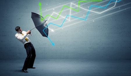 Business person with umbrella and colorful stock market arrows concept Stock Photo