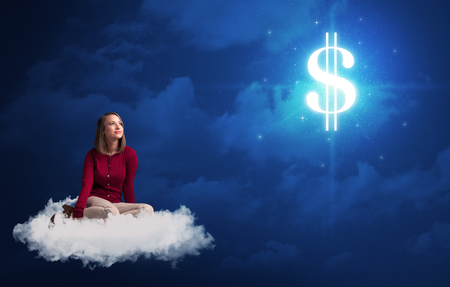 Caucasian woman sitting ona white fluffy cloud daydreaming of money