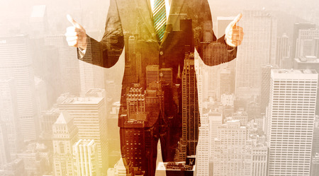 Business man looking at warm overlay city background