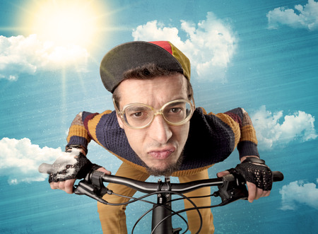 Nerd, crazy stylish rider on the bicycle with sunny weather Stok Fotoğraf