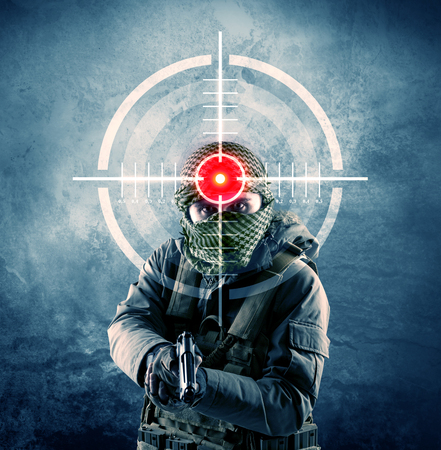 Masked terrorist man with gun and laser target on his body concept  Stok Fotoğraf
