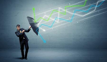 Business person with umbrella and colorful stock market arrows concept Banque d'images