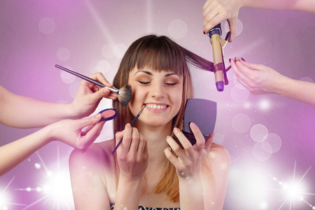 Young woman portrait with shiny pink beauty salon concept and personal styler hand