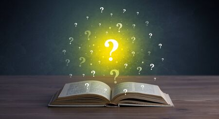 Yellow question marks hovering over open book