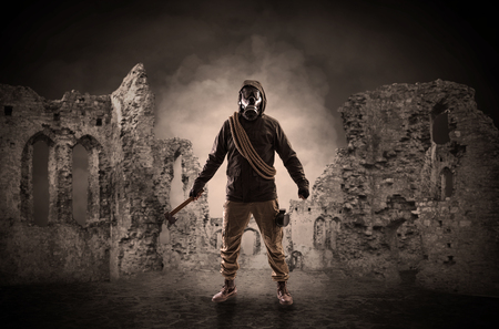 Hazard, menace man in a ruined crumbly building with arms on his hand  Stock Photo