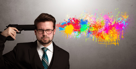 Concept of businessman frustrated with colors and creativity