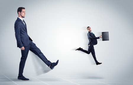 Young businessman fired cruel and aggressive by his boss with white background  Stock Photo