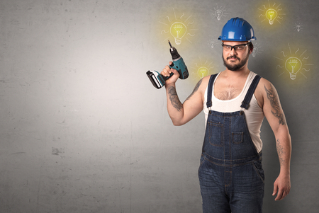 Craftsman with tool and new idea symbol in his hand. Imagens