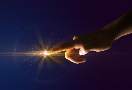 Female finger touching a beam of light Stock Photo