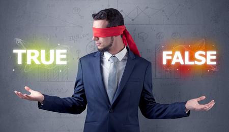 Businessman with red ribbon on his eye deciding true or false Reklamní fotografie