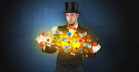 Young illusionist in tails hold between hands gambling staffs with super power Stock Photo
