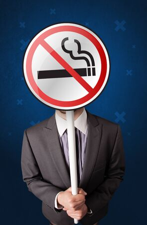 Smart businessman holding round sign with no smoking graphic