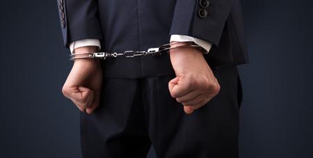 Close now arrested men hand with dark background and handcuffs Reklamní fotografie - 96607105