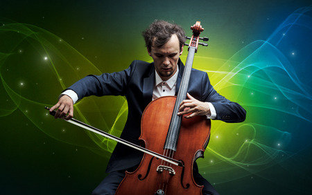 Serious classical cellist with fabled sparkling wallpaper Stock Photo
