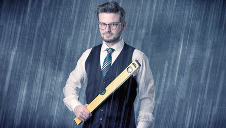 Young handsome  man holding tool with raindrop graphic
