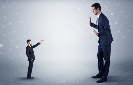 Small businessman aiming at a big businessman with connection and network concept Stock fotó - 97641326