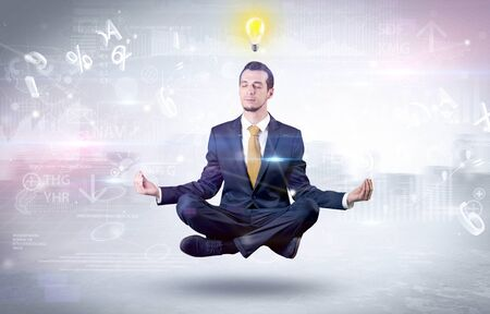 Businessman meditates with enlightenment data reports and financial concept  스톡 콘텐츠