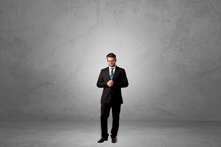 Alone businessman standing in a dark room Stock fotó