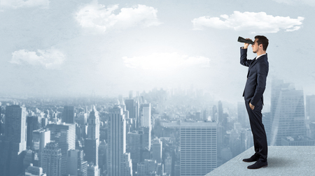 Man looking forward from the top of a skyscraper