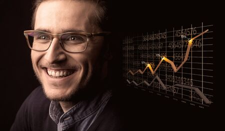 Happy businessman with a growing graph