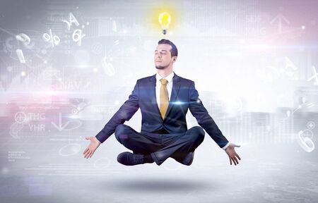 Businessman meditates with enlightenment concept Banco de Imagens