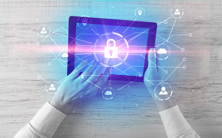 Hand using tablet with network security and online storage syste