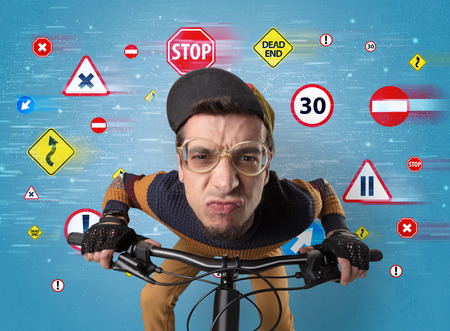 Stylish biker with highway code concept Stock Photo