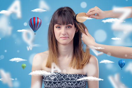 Young woman at hairdresser with air balloon theme Stock Photo