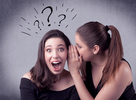 girl telling secret things to her girlfriend Stock Photo