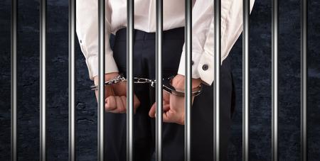 Close handcuffed man in jail 写真素材