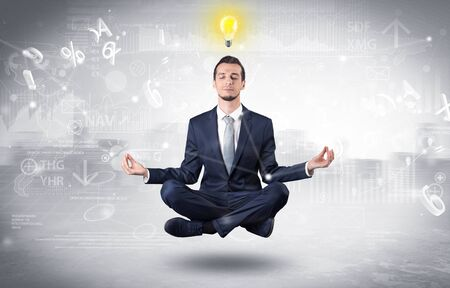 Businessman meditates with enlightenment concept Stock fotó