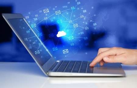 Hand using laptop with centralized cloud computing system concept
