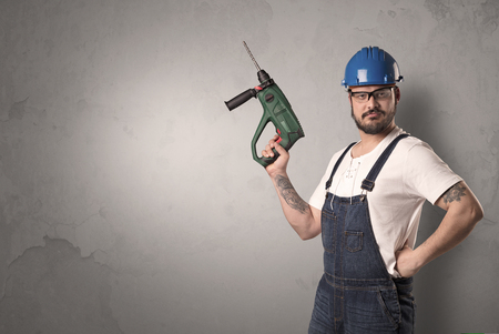 Craftsman standing in front of an empty wall. Stock Photo