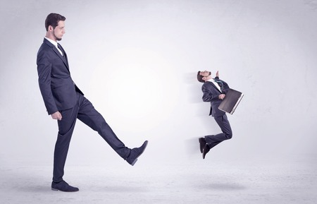 Big man kicking little himself out