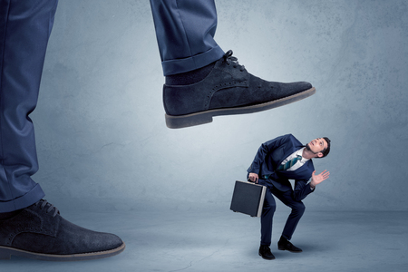 Trampled small businessman in suit Stock Photo - 98318295
