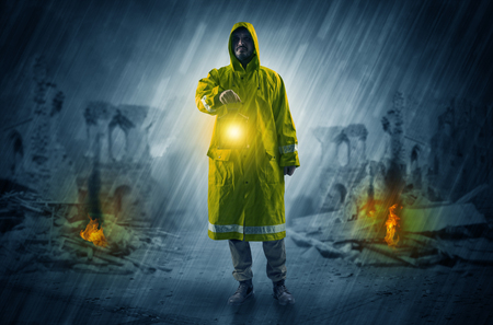 Man with a glowing lantern at a catastrophe scene