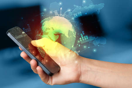 Hand using phone  with worldwide reports links and statistics concept 版權商用圖片