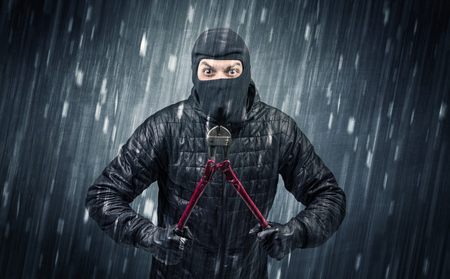 Caught burglar by house camera in action. Stock Photo