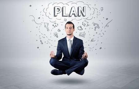 Businessman meditates with doodle concept Stock fotó