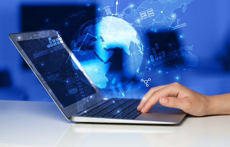 Hand using laptop with worldwide reports links and statistics concept
