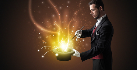 Magician hand conjure miracle from cylinder