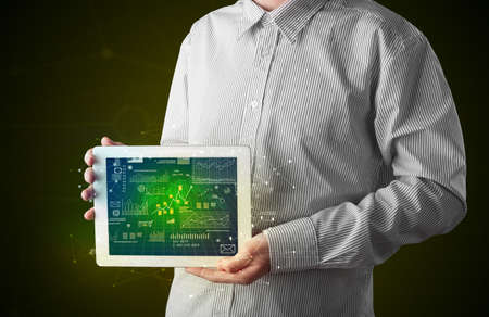 Businessman holding tablet with business plan concept Stock Photo