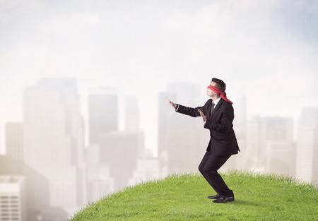 Blindfolded businessman walking
