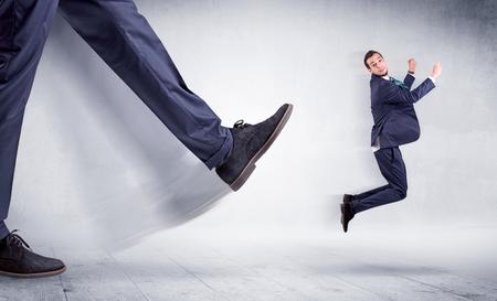 Big leg kicking small man Stock Photo
