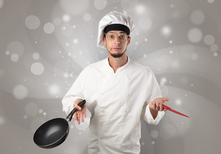 Male cook with shiny grey wallpaper Stock Photo