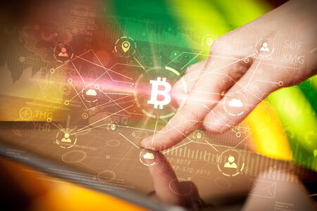 Hand using tablet with bitcoin link network and online concept