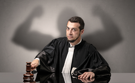 Brawny judge making decision Stock Photo